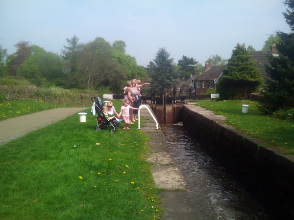 Family standing by canal lock