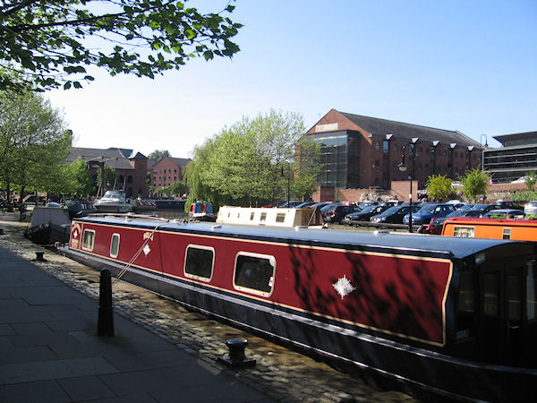 Narrowboat moored in sunshine in Castlefields Basin