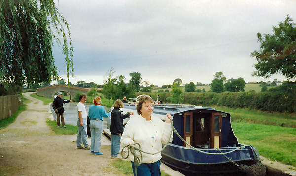 Mum leading boat into a lock